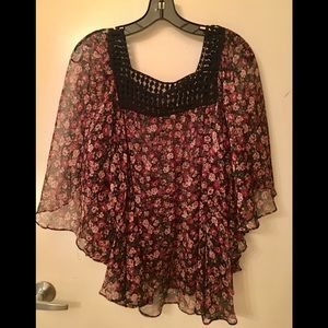 Loose fitting top.